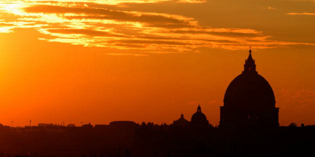 Beautiful colors in Rome at sunset with the Saint Peter Basilica silhouette